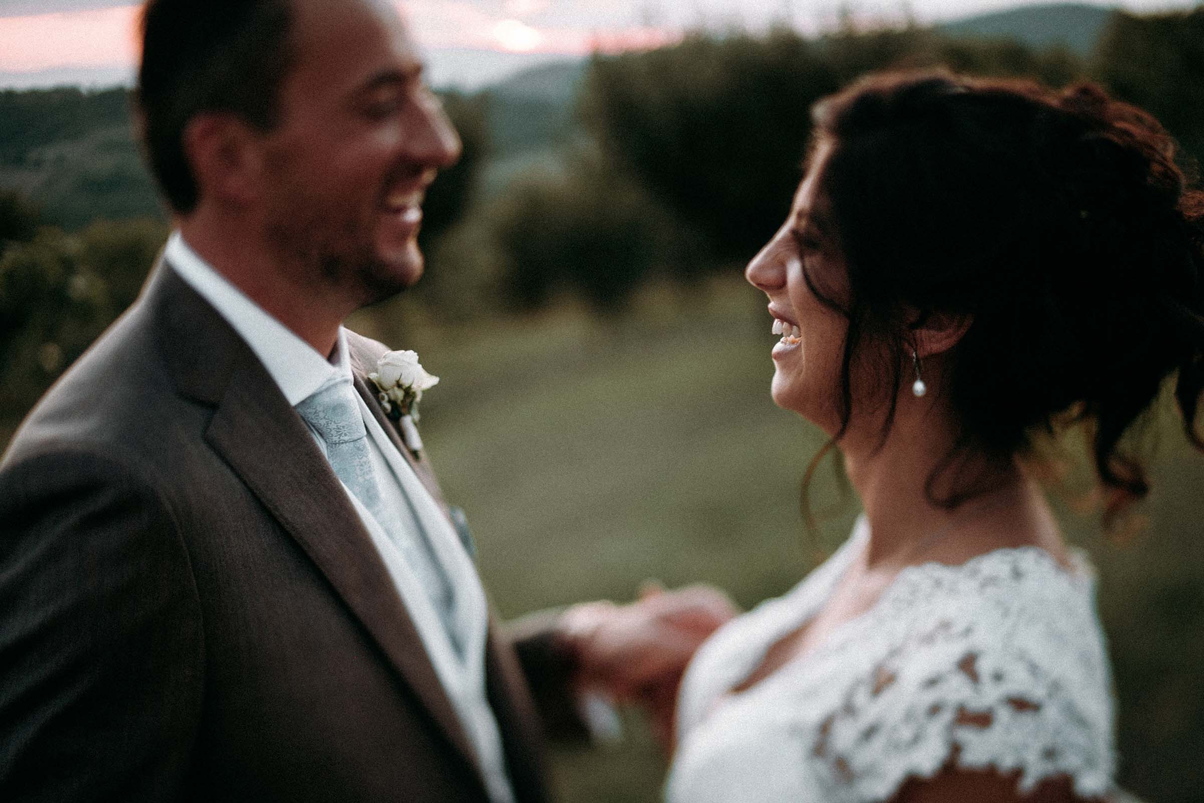 wedding couple laughing in love out of focus