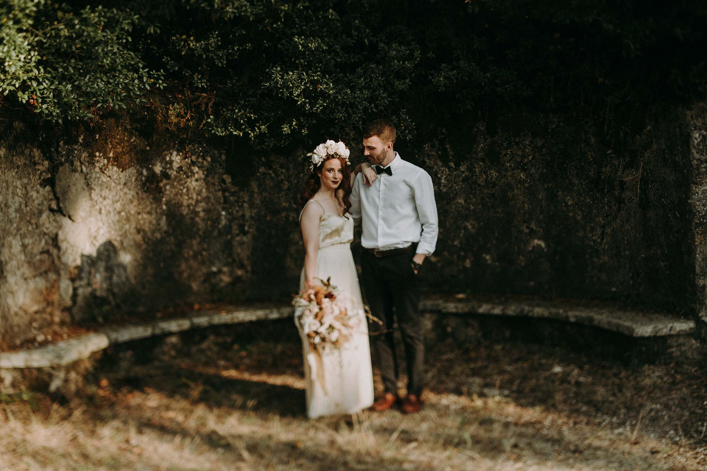 bride standing next to groom with arm on his shoulder