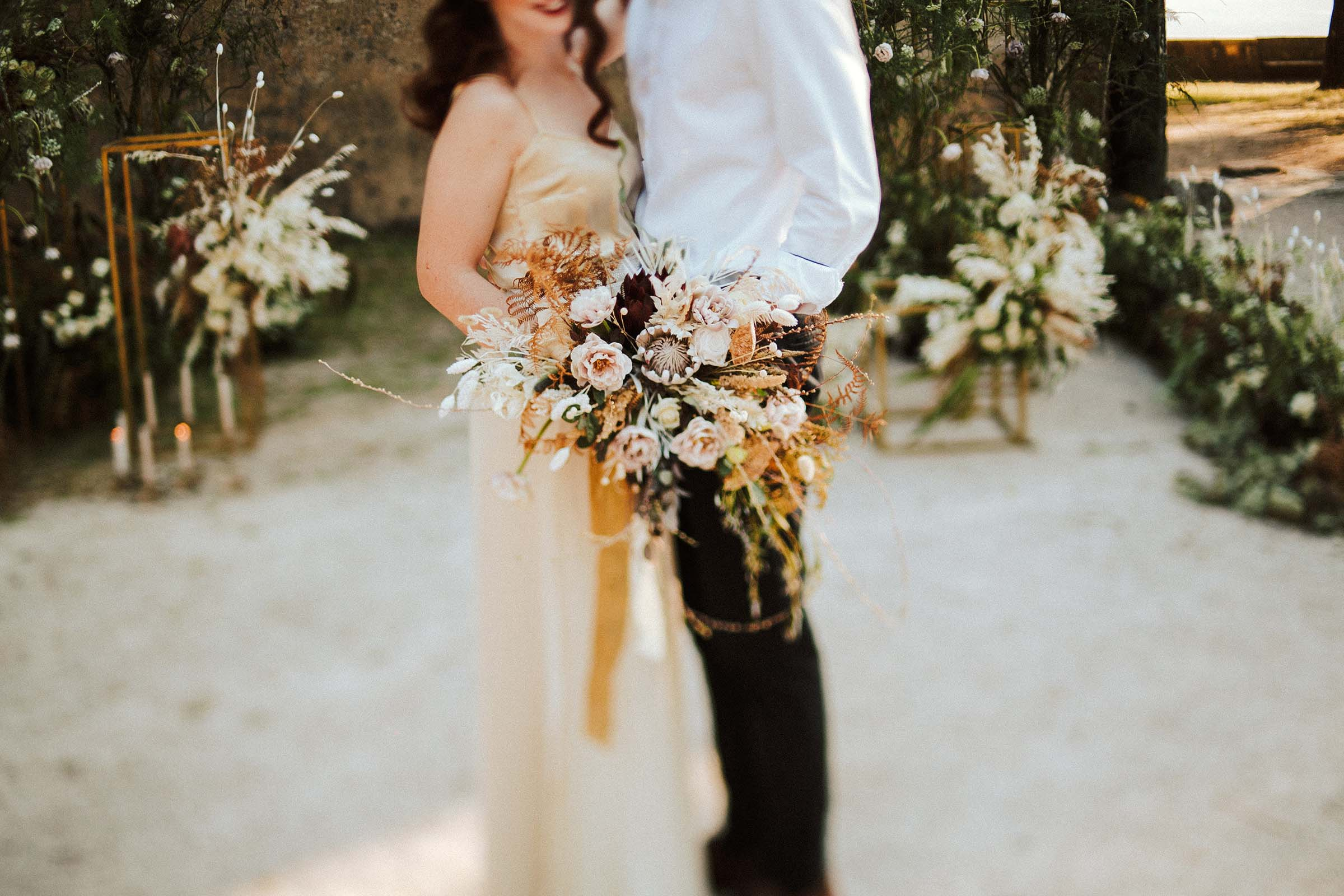 bouquet details with couple standing close together