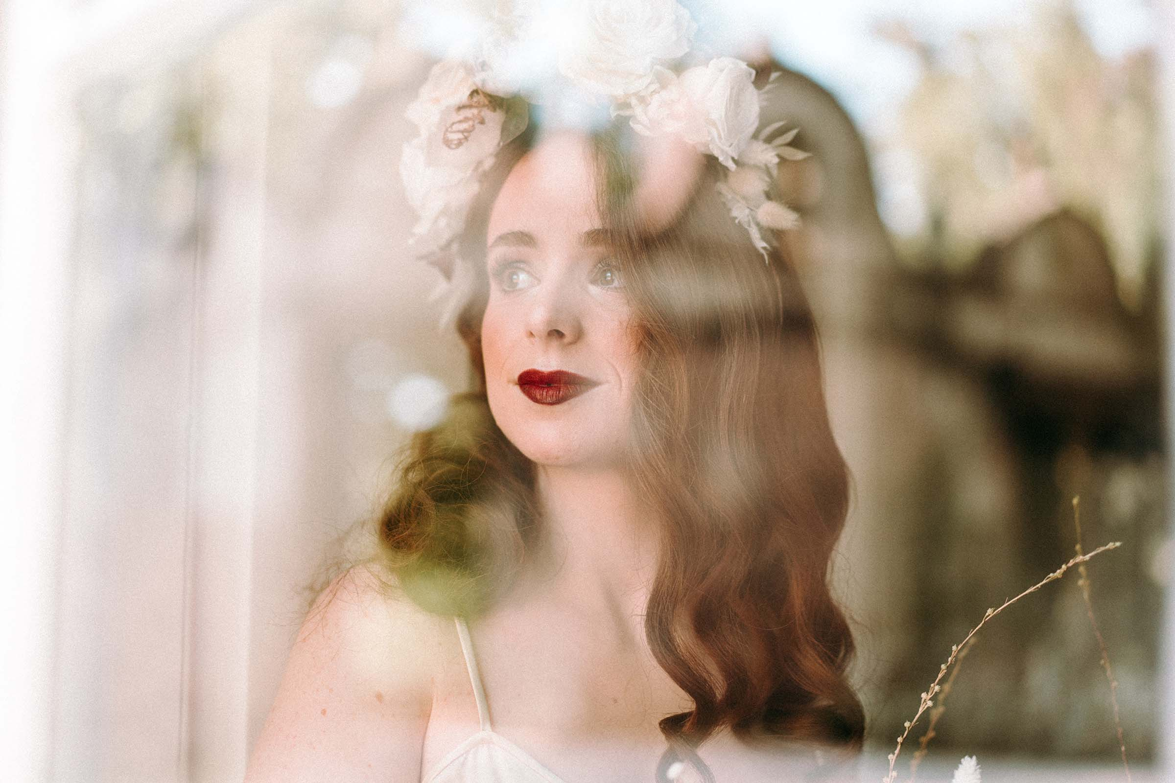 bride red lipstick looking through the window