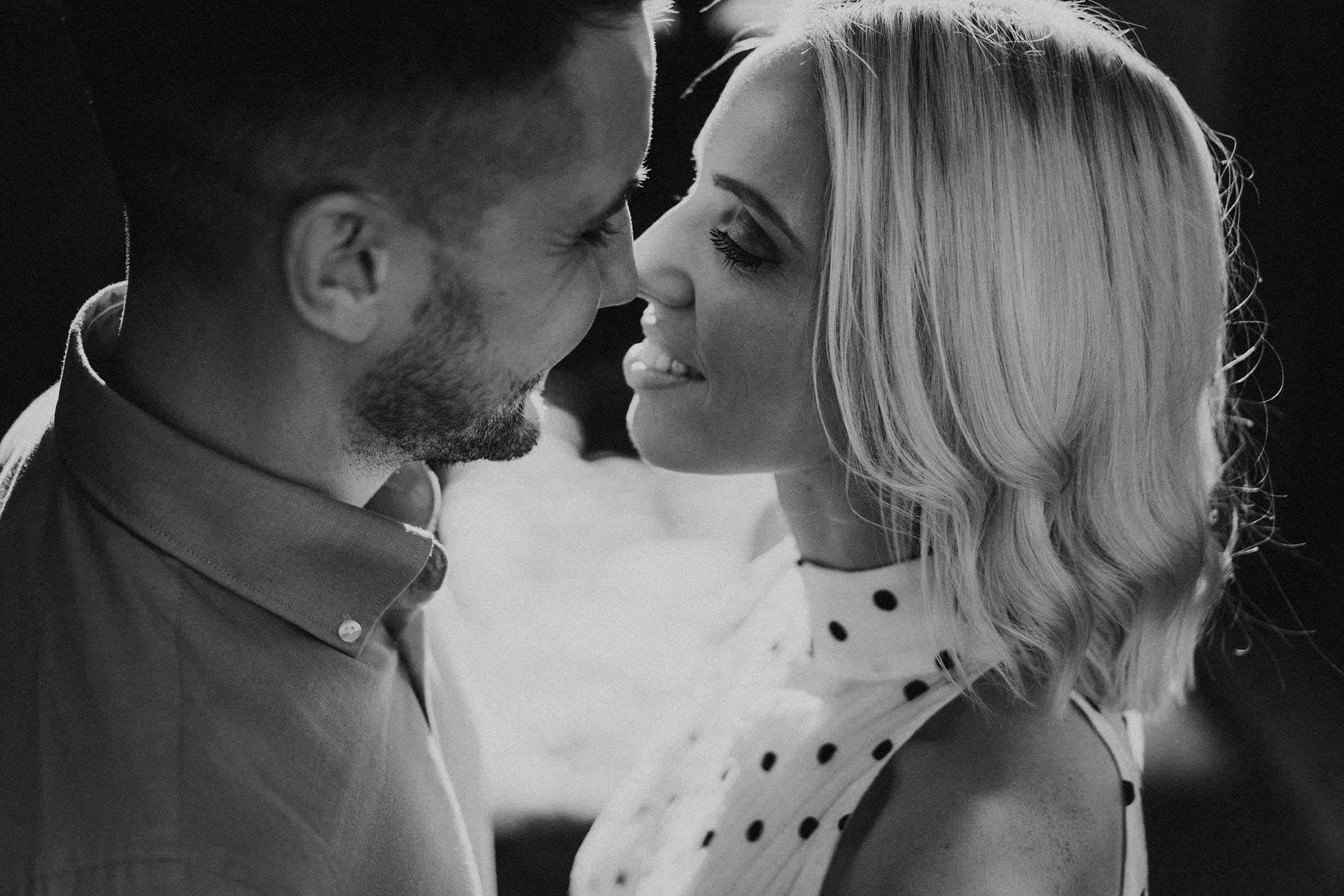 black and white photo couple really close to each other