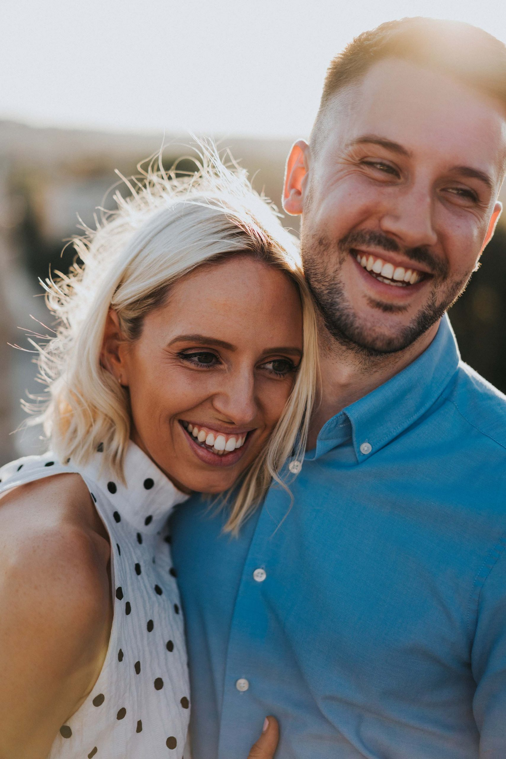 portrait photo couple laughing looking natural