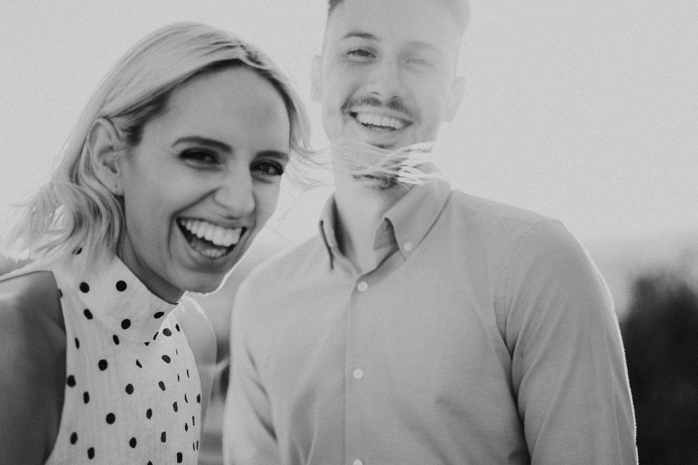 couple laughing in black and white