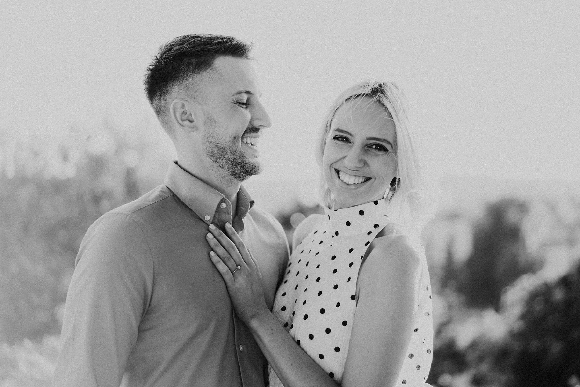 newly engaged couple photo in black and white