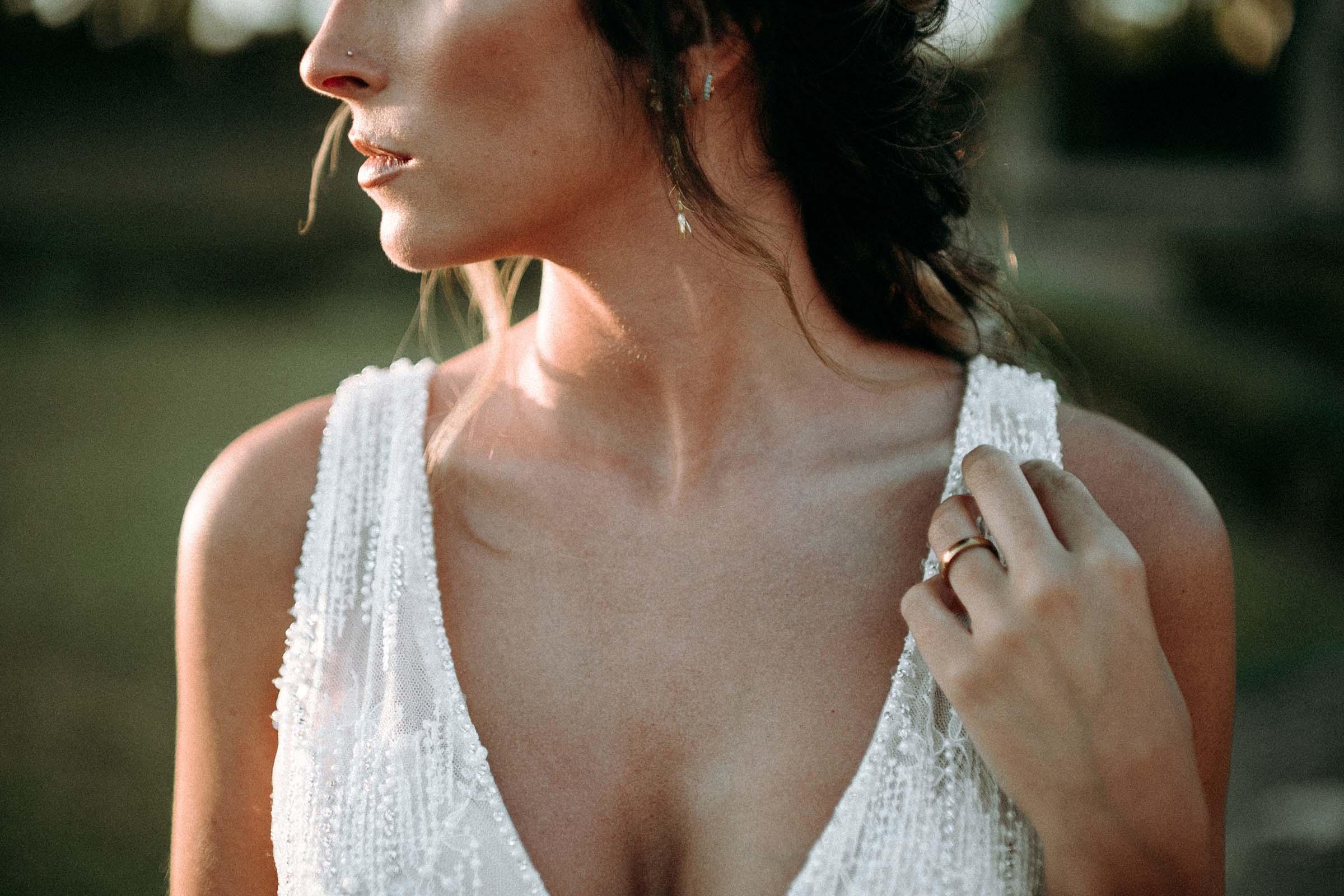 bride cleavage detail looking sideways