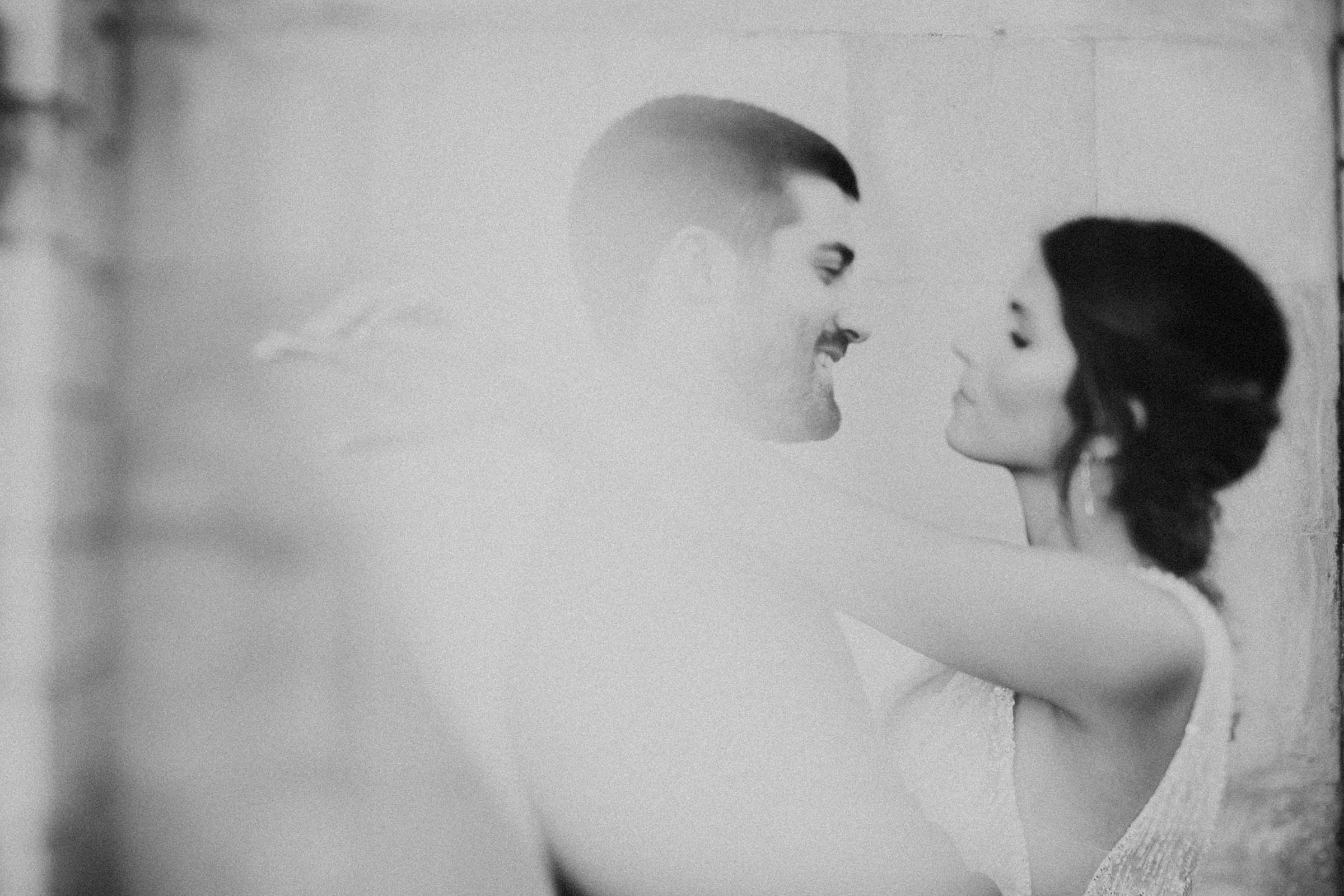 freelens black and white photo with bride hugging groom
