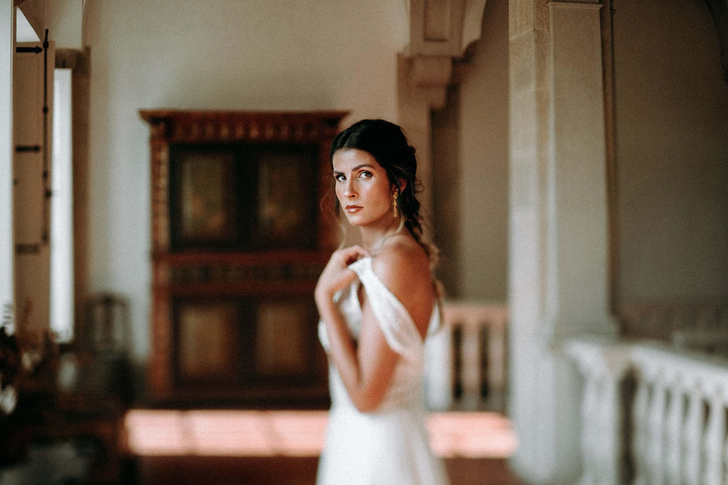 gorgeous bride pulling up wedding dress