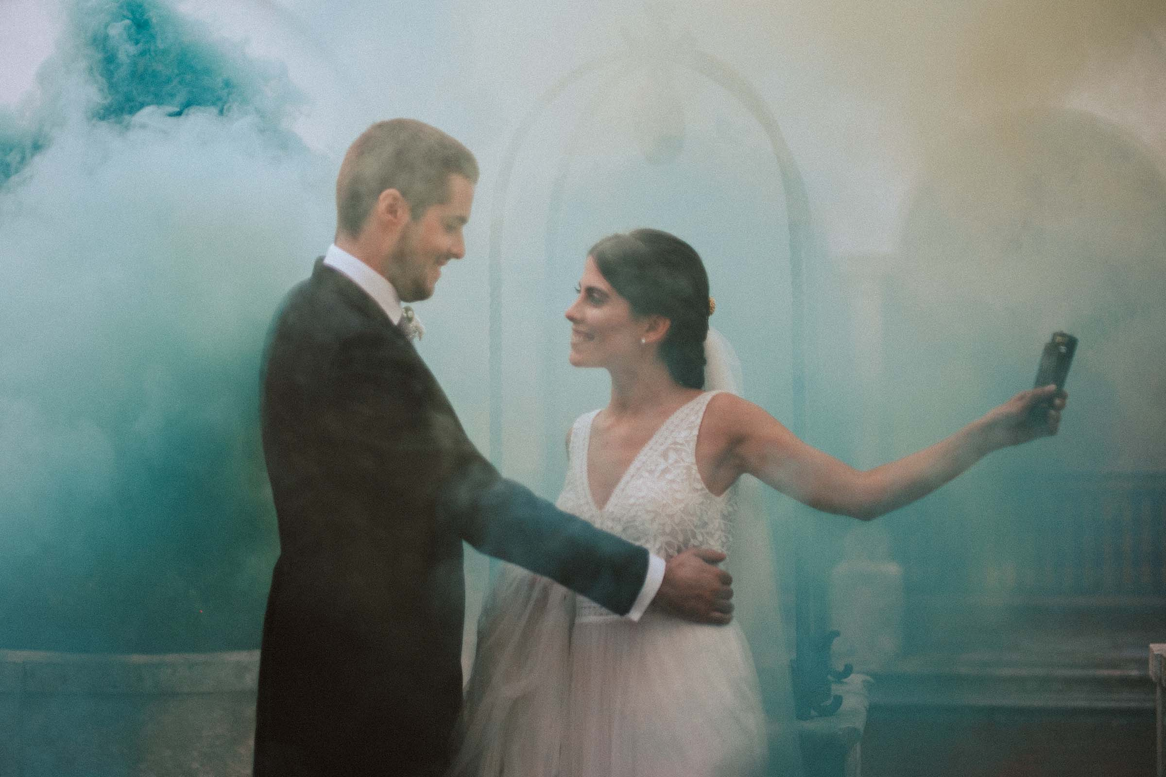 couple dancing in smoke bomb